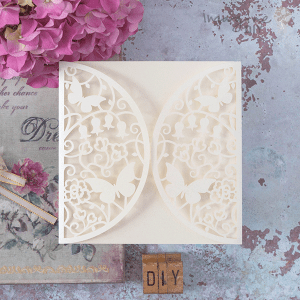 Meadow cream laser cut invitation. Cream laser cut invitation with lily of the valley and butterflies. DIY wedding stationery supplues