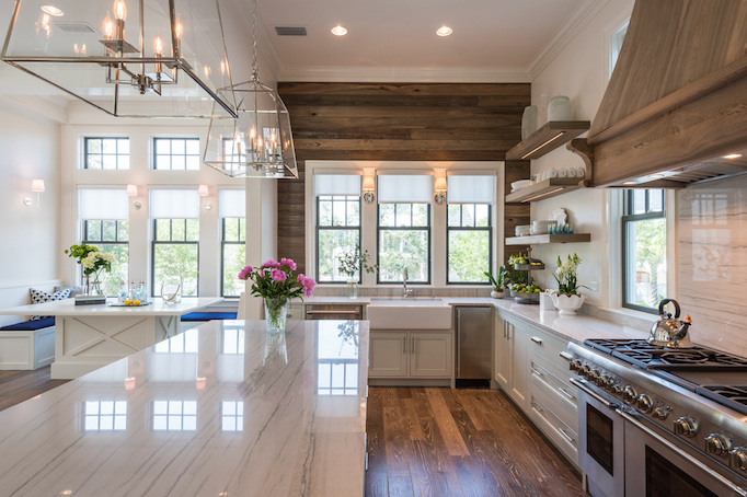 Beautiful kitchen inspiration with reclaimed wood wall, white cabinets and open shelving - Old Seagrove Homes
