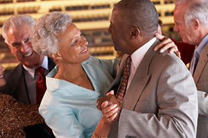 Senior couple dancing and thinking about long term care insurance options.