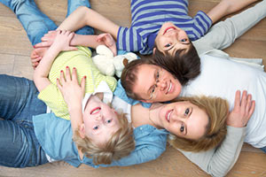 Young family considering term life insurance coverage.