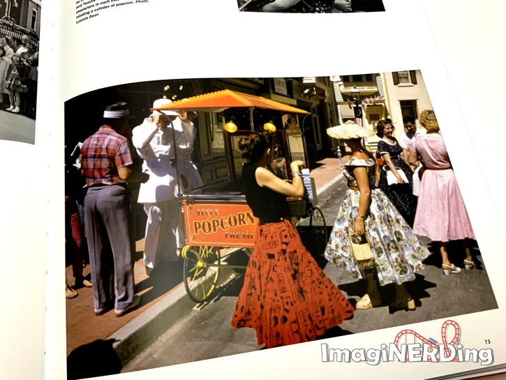 an image of people standing by the popcorn cart at Disneyland from Walt Disney's Disneyland book
