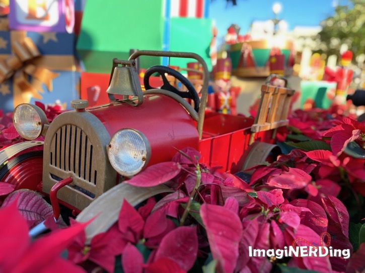 child's toy fire truck under the christmas tree at the magic kingdom