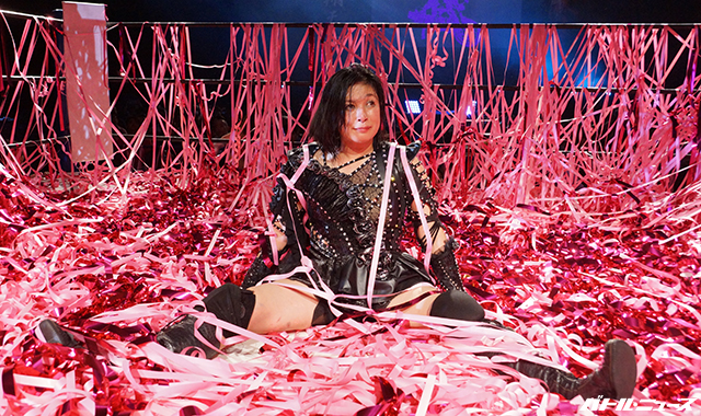 Manami Toyota sits in the streamers at her retirement show