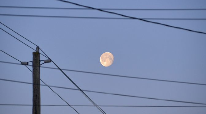 Snow Moonset and power lines