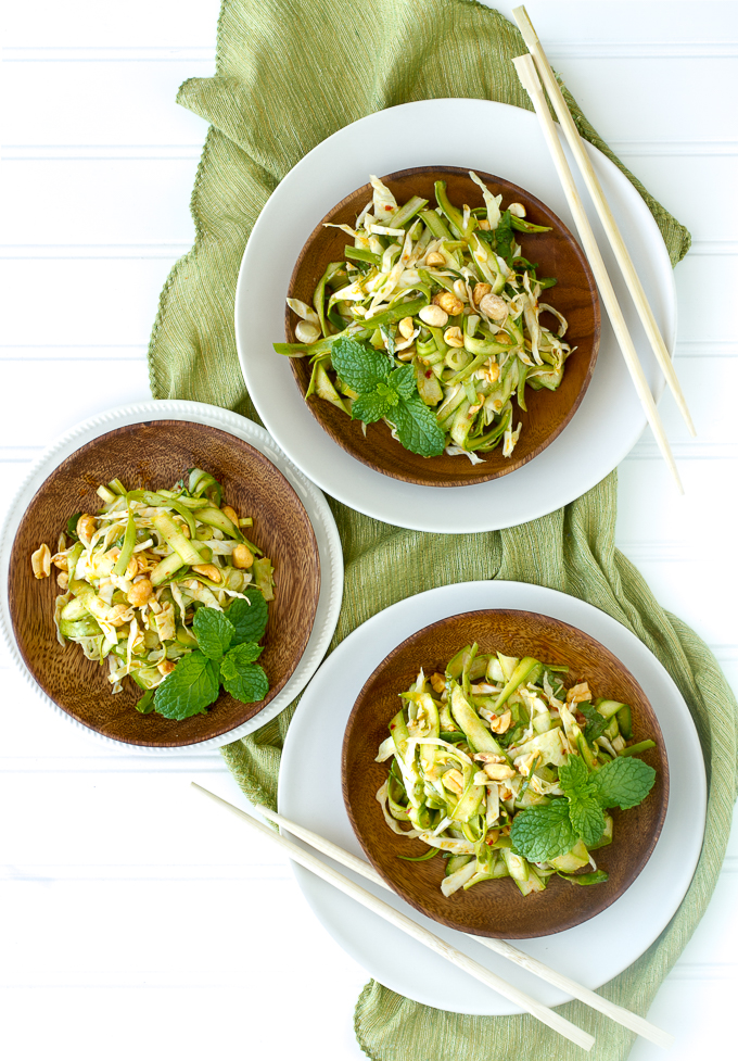 Shaved Asparagus Salad with an Asian Inspired dressing, tossed with cabbage, peanuts and mint.  A delicious vegetarian salad!