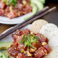Fresh Ahi Poke served with sesame rice crackers and seaweed salad. Makes a great appetizer or light meal. Healthy!