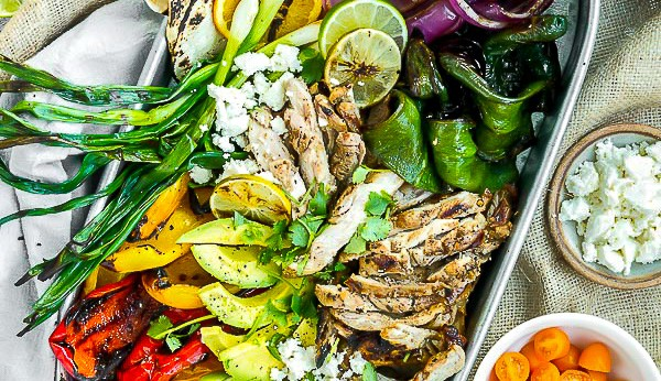 pollo asado tacos with grilled peppers, onions and warm tortillas