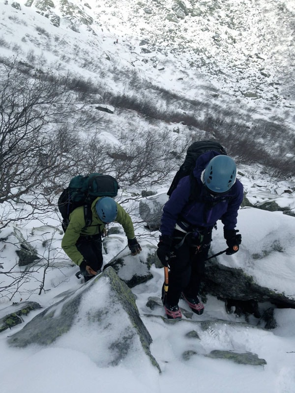 Ice tool, trekking poles, microspikes and snow-covered boulders--standard Mount Washington fare.