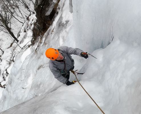 Ice climbing Standard Route at Frankenstein Cliffs in Crawford Notch, New Hampshire.