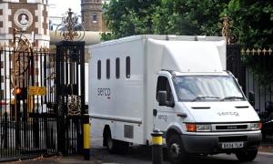 A Serco prison van leaving Wormwood Scrubs prison in west London
