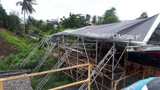 Billboard buckles amid strong winds in Naga City
