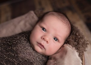 baby swaddled in brown. Jesus For You. Advent Devotion from Immanuel Lutheran Church in Joplin, Missouri. LCMS. Call His Name Jesus.