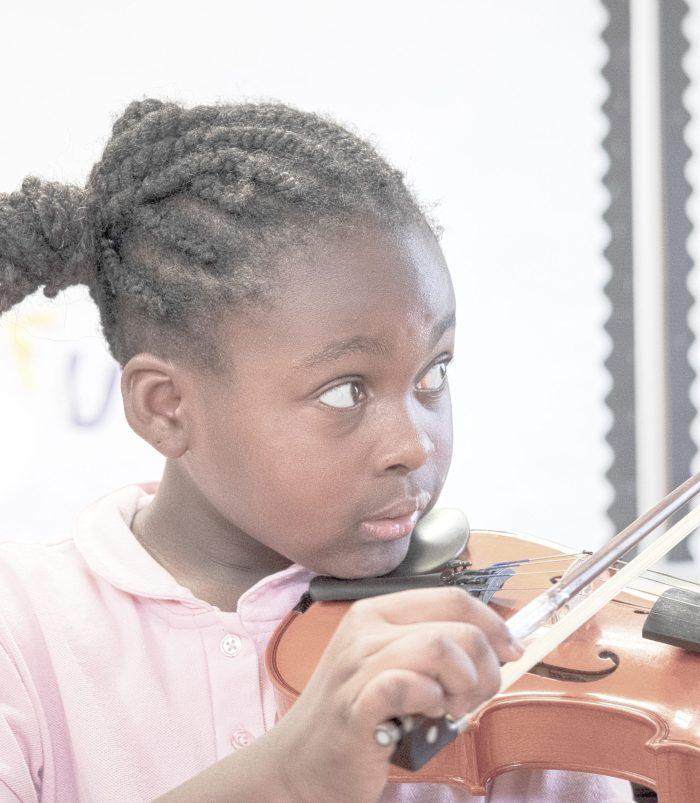 national lutheran schools week. girl playing violin. music class. 2020.