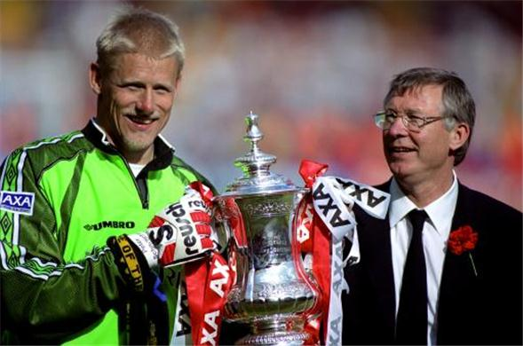 Schmeichel e Ferguson: dupla imortal do United.