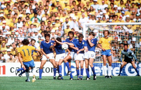 1982 World Cup Finals. Second Phase. Barcelona, Spain. 5th July, 1982. Italy 3 v Brazil 2. Members of the Italian team form a wall as Brazil's Eder takes a free kick.