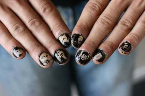 Fingernails with faces.