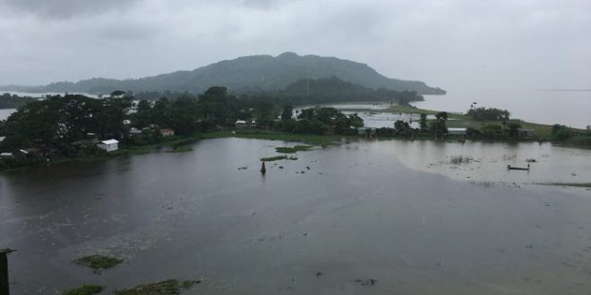 Picture : The Brahmaputra (in the background) overflows its banks near Dhubri in Lower Assam during the August 2017 flood [Image by Sucharita Sen