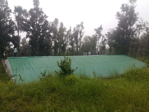 This rainwater harvesting tank on the hilltop above Nag village stores almost 400,000 litres [Image by Hridayesh Joshi]