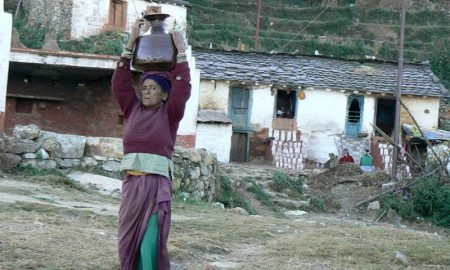 In the Himalayas, most women have to walk miles on hilly terrain to fetch water as local water sources are depleting [Image by Hridayesh Joshi]