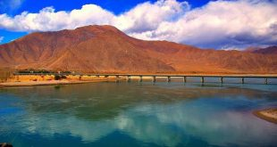A bridge over the Yarlung Tsampo / Brahmaputra, in the west of Lhasa [image by Eric/Flickr]