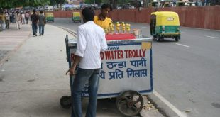 A man selling refrigerated water on Delhi's street [image by: Chris Wilson]