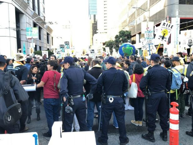 Environmental activists and police face off on the opening day of the GCAS [image by: Joydeep Gupta]