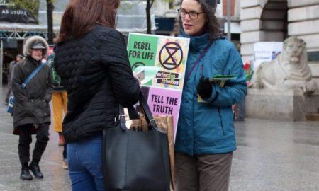 A campaigner informs a pedestrian about extinction level threats [image by: kthtrnr/Flickr]