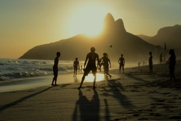 stock-footage-silhouettes-of-carioca-brazilians-playing-altinho-keepy-uppy-beach-football-at-sunset-on-ipanema