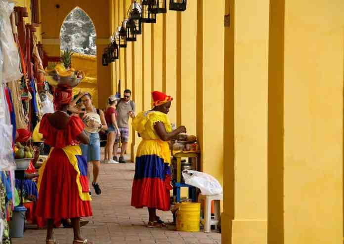 Women selling handicrafts and other items in a colorful outdoor market in cartagena, colombia