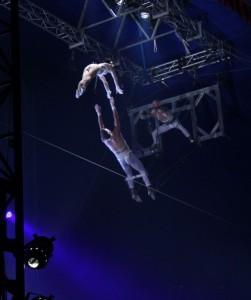 Kyla Duffy climbing from bottom catcher, Daniel Simard, to top catcher, Jeremy Chute