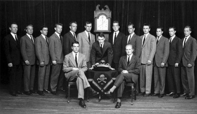 """Psychopath defined? The Skull and Bones. On the table is the stolen skull of Geronimo, sacred burial remains over which his heirs sued. To the right of the clock is George H. W. Bush. In regards to the skull, consider this: President John Quincy Adams concluded in his Address to the People of Massachusetts: """"I saw a code of Masonic legislation adapted to prostrate every principle of equal justice and to corrupt every sentiment of virtuous feeling in the soul of him who bound his allegiance to it…. I saw the practice of common honesty, the kindness of Christian benevolence, even the abstinence of atrocious crimes; limited exclusively by lawless oaths and barbarous penalties, to the social relations between the Brotherhood and the Craft. I saw slander organize into a secret, widespread and affiliated agency….I saw self-invoked imprecations of throats cut from ear to ear, of hearts and vitals torn out and cast off and hung on spires. I saw wine drunk from a human skull with solemn invocation of all the sins of its owner upon the head of him who drank it."""""""