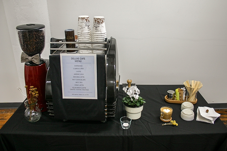 Espresso bar setup on a table with black tablecloth