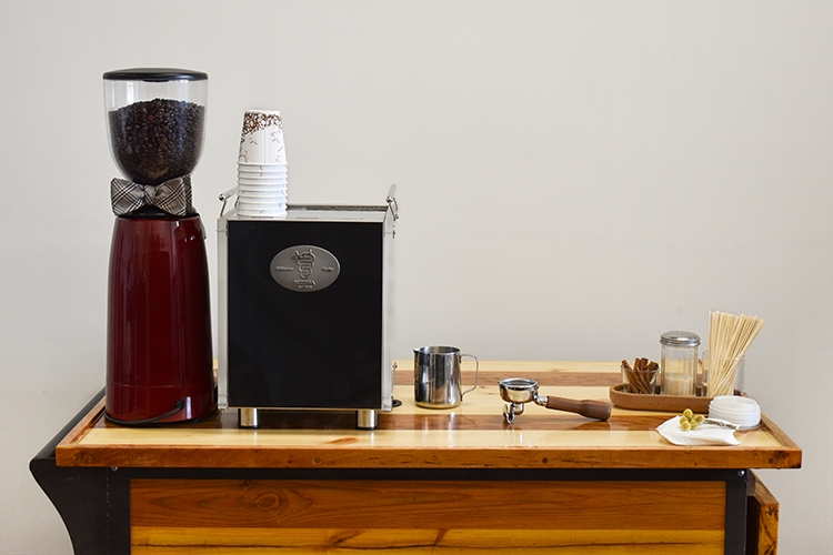 Espresso bar setup on a wooden cart