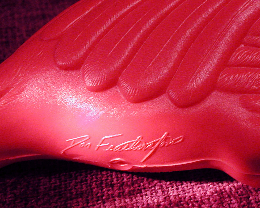 The signature of Don Featherstone the creator of theplastic pink flamingo is molded into the