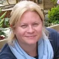 Picture of Mary Ann Clark wearing blue shirt and light blue scarf.