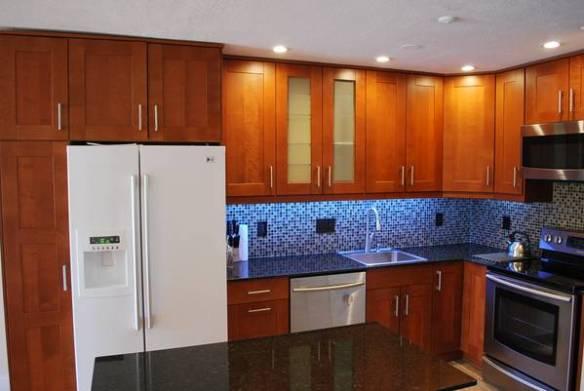 Full kitchen design, cabinets installation, hardwood and tiles floors, countertops