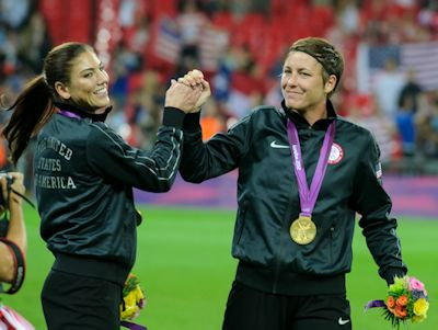 Hope Solo (L) and Abby Wambach (R) congratulate each other after winning the 2012 London Olympic Gold Medal.
