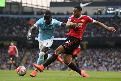 Manchester United's Anthony Martial (blue) and Bacary Sagna (red) of Manchester City during the Barclays Premier League match between Manchester City and Manchester United played at the Etihad Stadium, Manchester on March 20, 2016.