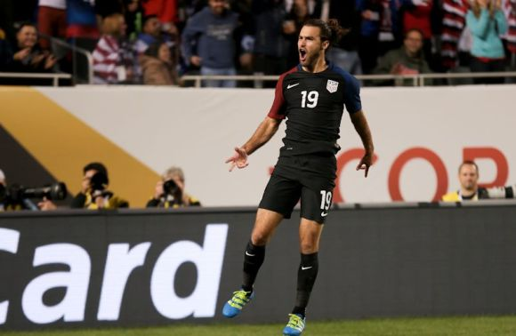 Graham Zusi celebrates after his goal gives the USA a 4 - 0 lead over Costa Rica on June 7, 2016 at Soldier Field in Chicago, Ill.