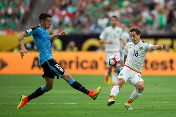 Matias Vecino of Uruguay and Andres Guardado of Mexico battle for the ball.  Guardado is later sent off.