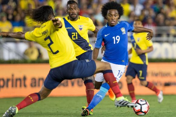 Willan (19) fights for the possession on June 4th at The Rose Bowl in Pasadena, CA. Brazil and Ecuador tied at 0 - 0. Photo by Celso Bayo.
