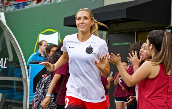 Allie Long high fives fans at Providence Park in Portland prior to a NWSL regular season match on June 22, 2016. Photo by Craig Mitchelldyer.
