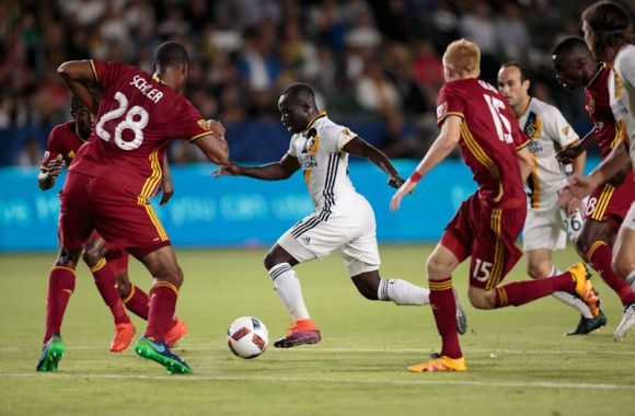 Emmanuel Boateng (center) shows his composure while amidst the Real Salt Lake defenders. Boateng and the Galaxy defeated Real Salt Lake 3 - 1 on October 26, 2016 at the Stub Hub Center. Photo by Michael Janosz.