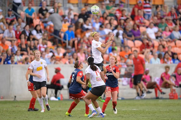 Lynn Williams (in air) of Western New York Flash battles for the ball during the NWSL Championship match between the Washington Spirit and the Western New York Flash at BBVA Compass Stadium in Houston.