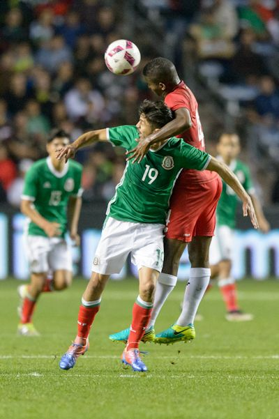 Bridgeview, IL, USA - Tuesday, October 11, 2016: Mexico forward Oribe Peralta (19) and Panama defender Fidel Escobar (4) during an international friendly soccer match between Mexico and Panama at Toyota Park. Mexico won 1-0.