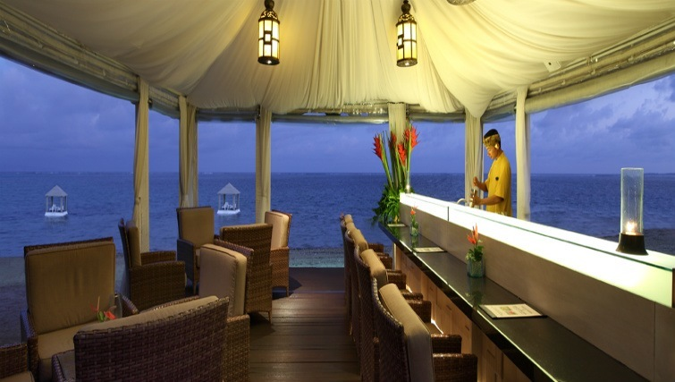 Ocean view open-air dining at Puri Santrian