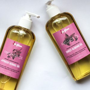 2 bottles of massage oil with pink label, one is apricot kernel the other sweet almond handcrafted by IN BLOOM HOMESTEAD