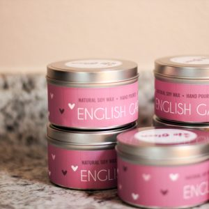 Candles with dark purple Label saying english garden made by In Bloom Homestead