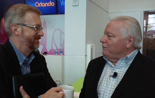 Huddling during the press reception are TIA National Chairman Todd Davidson (left), who is also CEO of Travel Oregon, and Roger Dow, president and CEO of the U.S. Travel Association