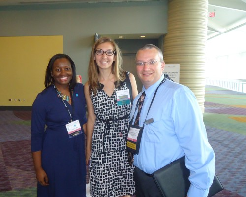 Pausing just outside the Media Marketplace are Moneé Cottman, national public relations manager for Visit Baltimore; Leslie Troy, communications specialist for the Maryland Office of Tourism Development; and Carl Whitehill, director of communications for Destination Gettysburg.